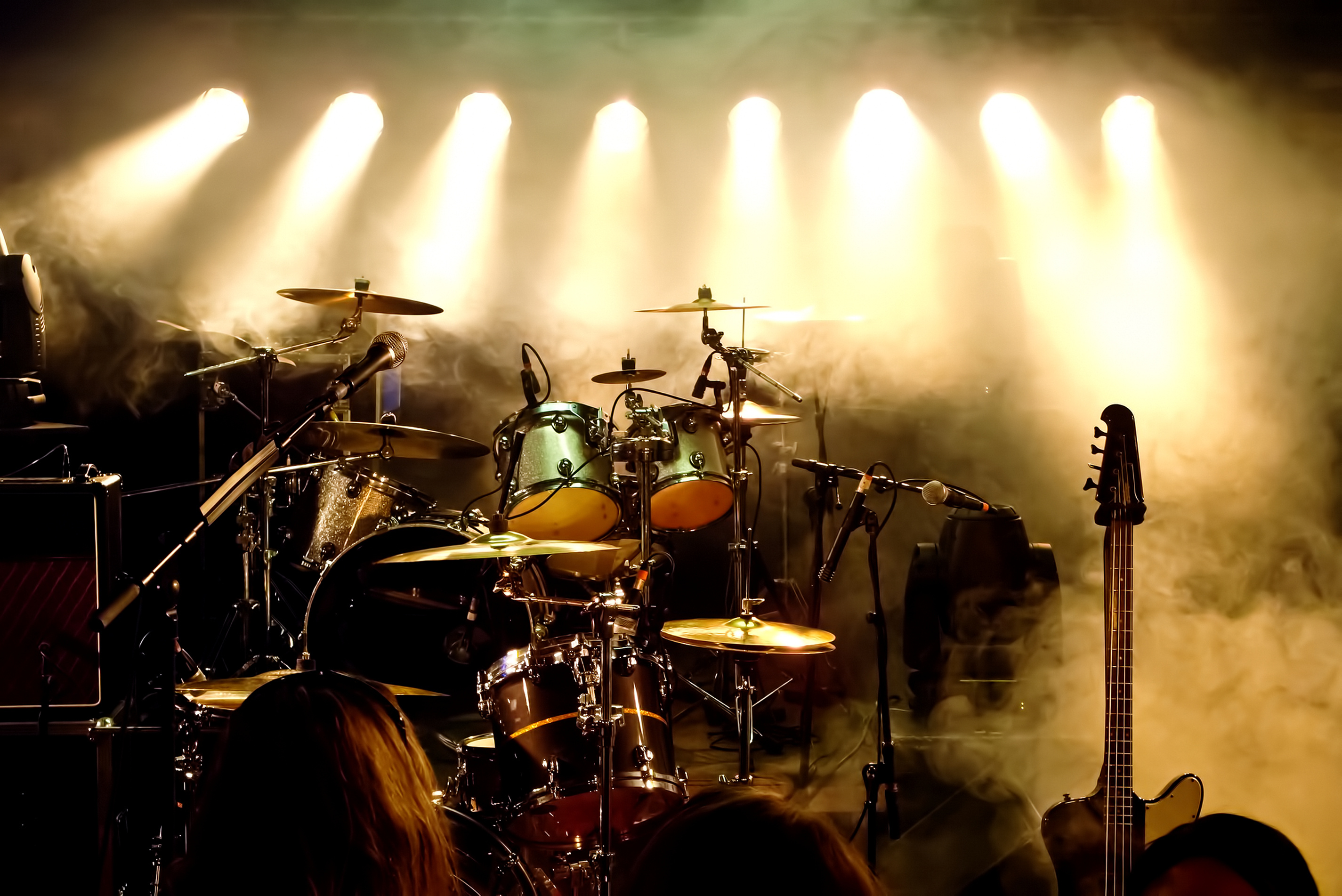 Drums on stage with back lighting
